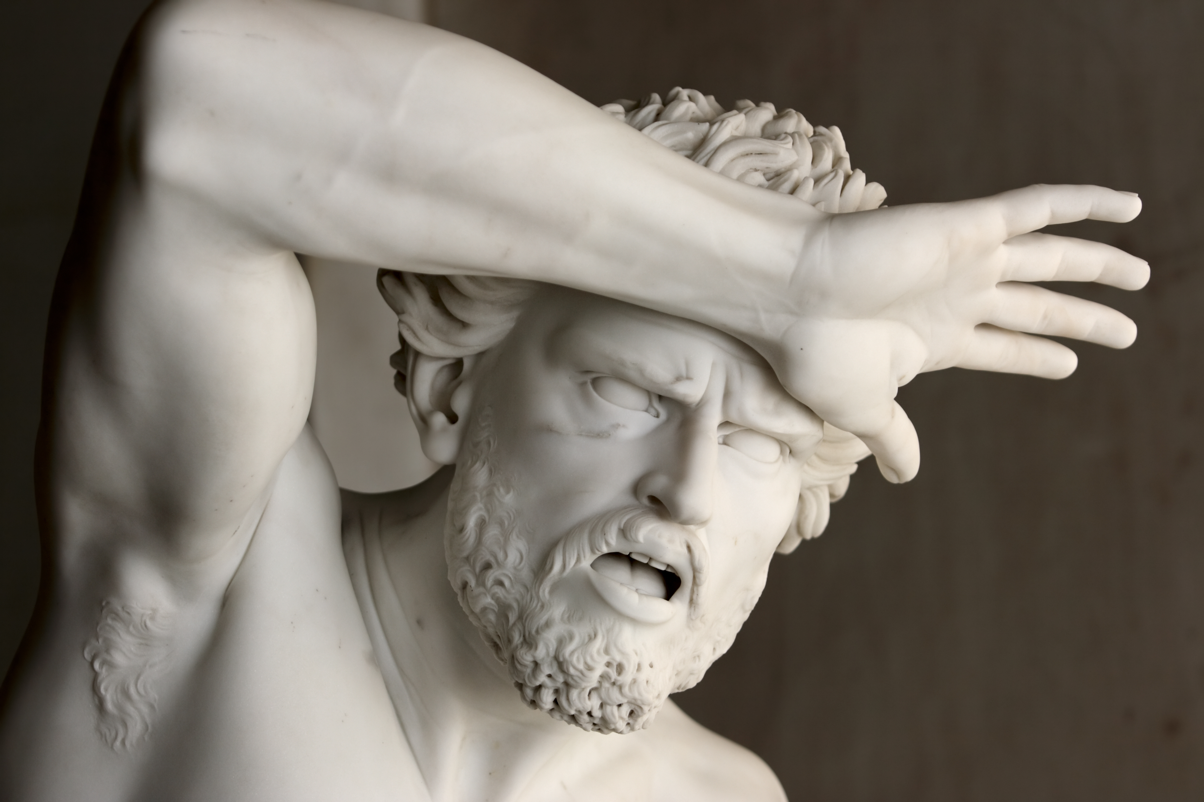 Fear (statue of shocked man protecting his head with hand)
