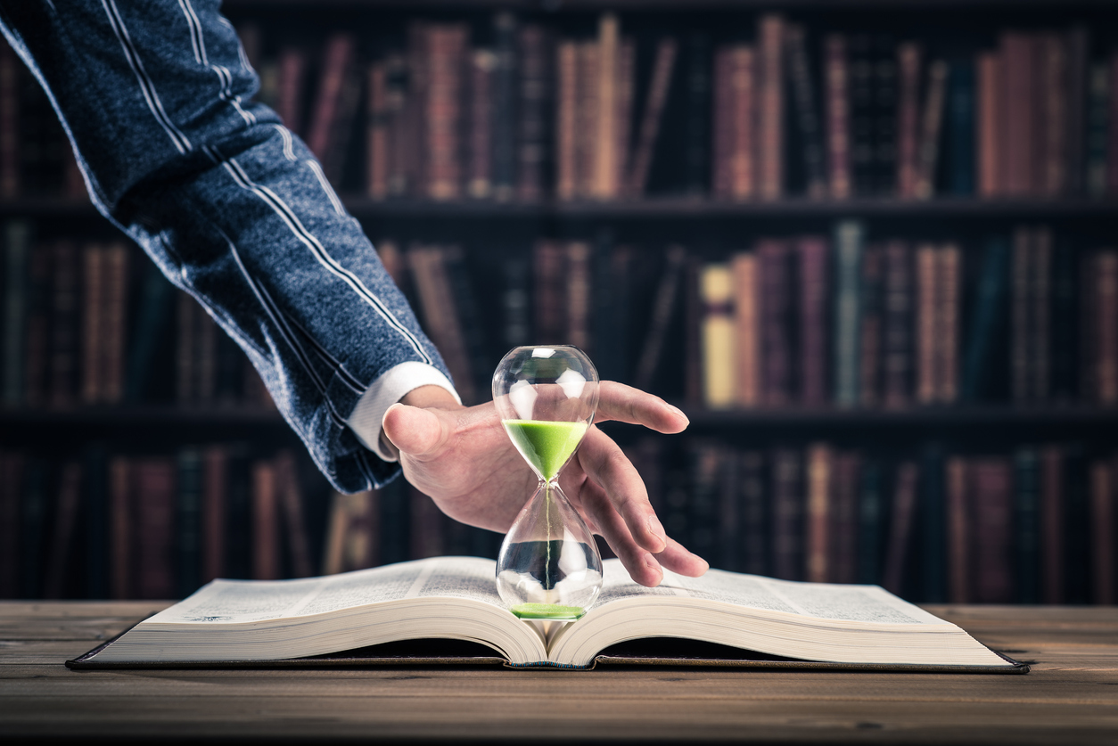 Hourglass and book