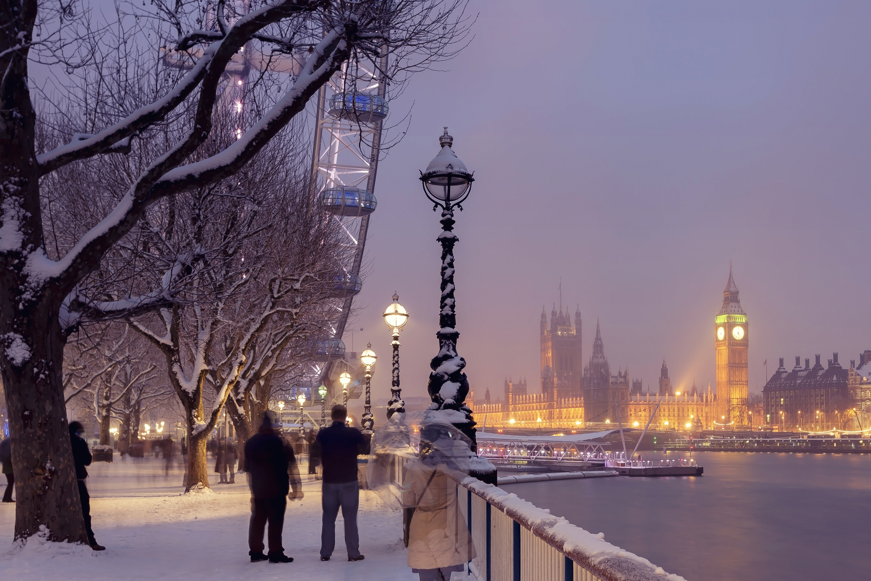 Snowy Jubilee Gardens and Westminster Palace in London